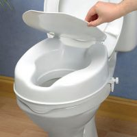 white raised toilet seat with fixing clamps