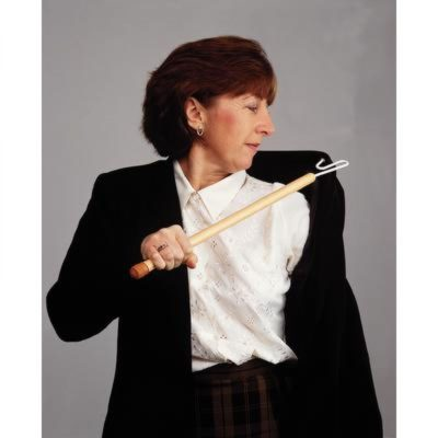 woman using dressing stick to help put on jacket