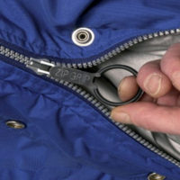 black zip grip aid attached to jacket